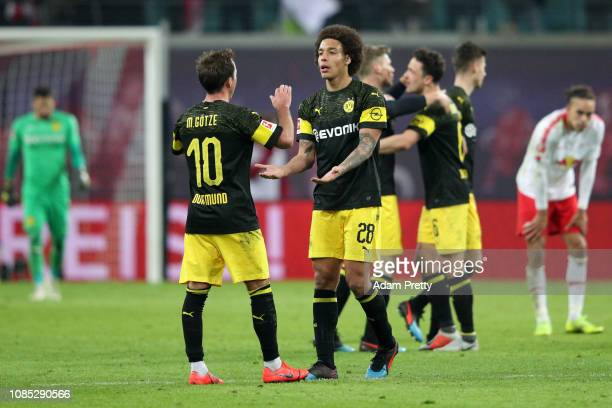 Axel Witsel of Borussia Dortmund celebrates victory with Mario Gotze of Borussia Dortmund after the Bundesliga match between RB Leipzig and Borussia...