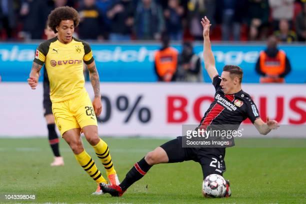 Axel Witsel of Borussia Dortmund Dominik Kohr of Bayer Leverkusen during the match between Bayer Leverkusen v Borussia Dortmund at the BayArena on...