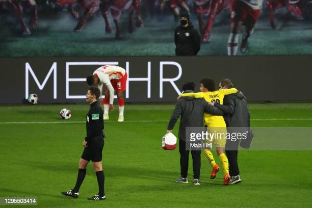 Axel Witsel of Borussia Dortmund is carried off during the Bundesliga match between RB Leipzig and Borussia Dortmund at Red Bull Arena on January 09,...