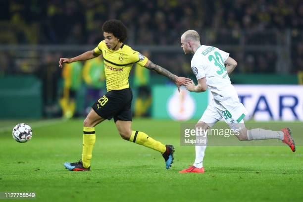 Axel Witsel of Borussia Dortmund is challenged by Davy Klaassen of Werder Bremen during the DFB Cup match between Borussia Dortmund and Werder Bremen...