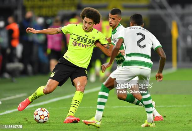 Axel Witsel of Borussia Dortmund is challenged by Matheus Nunes of Sporting CP during the UEFA Champions League group C match between Borussia...