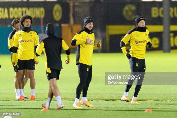 Axel Witsel of Borussia Dortmund Julian Brandt of Borussia Dortmund and Erling Haaland of Borussia Dortmund look on ahead of the UEFA Champions...
