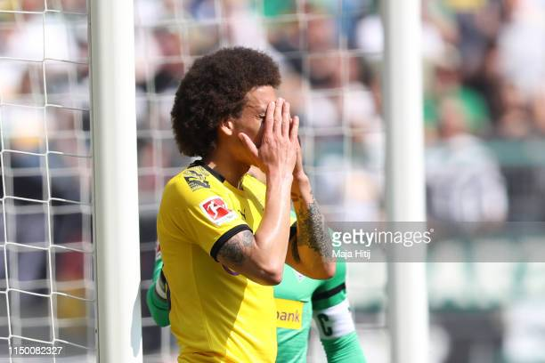 Axel Witsel of Borussia Dortmund reacts during the Bundesliga match between Borussia Moenchengladbach and Borussia Dortmund at Borussia-Park on May...