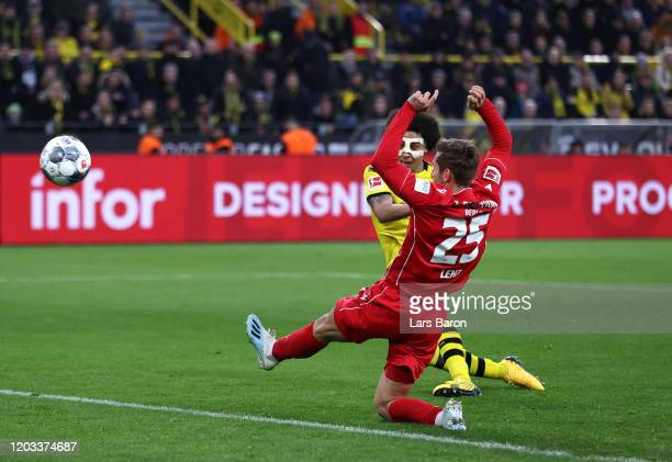 Axel Witsel of Borussia Dortmund scores his team's fourth goal as he is challenged by Christopher Lenz of 1. FC Union Berlin during the Bundesliga...