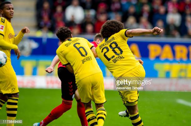 Axel Witsel of Borussia Dortmund scores the opening goal during the Bundesliga match between Sport-Club Freiburg and Borussia Dortmund at the...
