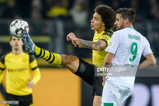 Axel Witsel of Dortmund battles for the ball with Martin Harnik of Bremen during the Bundesliga match between Borussia Dortmund and SV Werder Bremen...