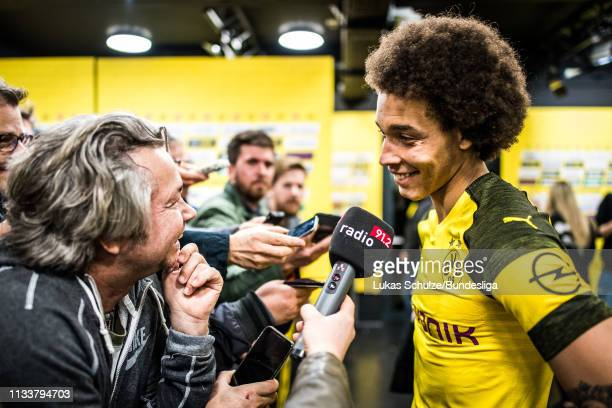 Axel Witsel of Dortmund gives an interview in the mixed zone after the Bundesliga match between Borussia Dortmund and VfL Wolfsburg at Signal Iduna...