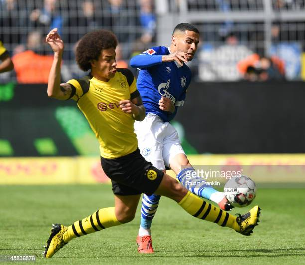 Axel Witsel of Dortmund is challenged by Omar Mascarell of Schalke during the Bundesliga match between Borussia Dortmund and FC Schalke 04 at Signal...