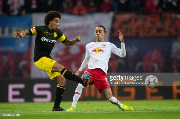 Axel Witsel of Dortmund is challenged by Yussuf Poulsen of Leipzig during the Bundesliga match between RB Leipzig and Borussia Dortmund at Red Bull...