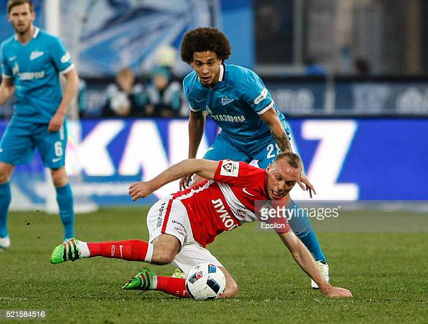 Axel Witsel of FC Zenit St Petersburg and Denis Glushakov of FC Spartak Moscow vie for the ball during the Russian Football League match between FC...