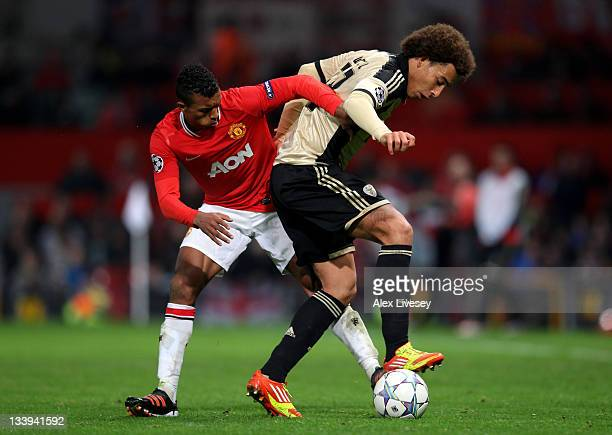 Axel Witsel of SL Benfica competes with Nani of Manchester United during the UEFA Champions League Group C match between Manchester United and SL...