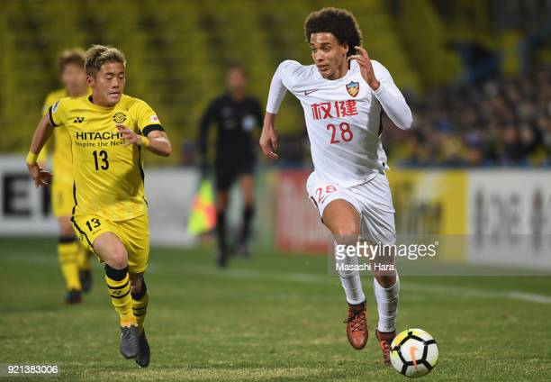 Axel Witsel of Tianjin Quanjian and Ryuta Koike of Kashiwa Reysol compete for the ball during the AFC Champions League match between Kashiwa Reysol...