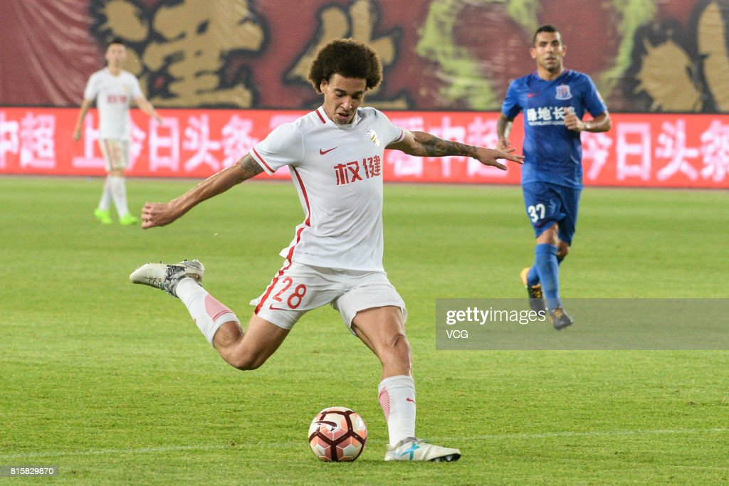 Axel Witsel #28 of Tianjin Quanjian shoots the ball during the 17th round match of 2017 Chinese Football Association Super League (CSL) between Tianjin Quanjian and Shanghai Shenhua at Haihe Educational Football Stadium on July 16, 2017 in Tianjin, China.