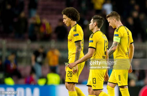 Axel Witsel, Raphael Guerreiro and Marco Reus of Borussia Dortmund react after the final whistle during the Group F - UEFA Champions League match...