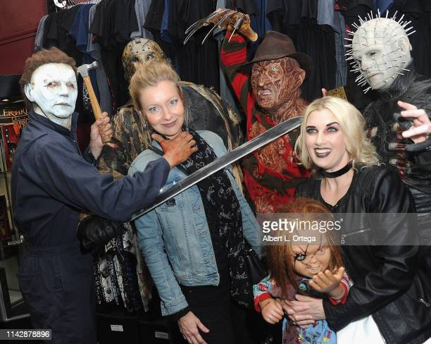 Axelle Carolyn poses with Michael Myers Jason Voorhees Freddy Kreuger Pinhead and Tiffany at the Dark Delicacies Grand Opening Party held at Dark...