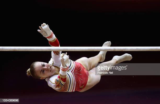 Axelle Klinckaert of Belguim competes in the Women's Uneven Bars Qualification during day three of the 2018 FIG Artistic Gymnastics Championships at...