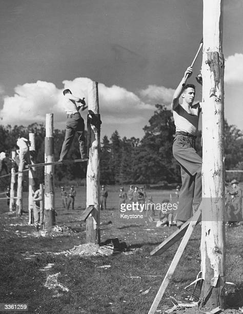 Axemen and lumberjacks from the dominion countries take part in a tree felling contest during the 'Axeman's Carnival' at Cirencester These skilled...