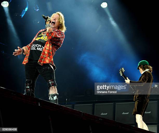 Axl Rose and Angus Young of AC/DC perform at Etihad Stadium on June 9 2016 in Manchester England