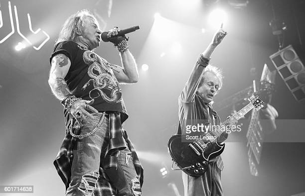 Axl Rose and Angus Young of AC/DC perform during the Rock Or Bust Tour at The Palace of Auburn Hills on September 9 2016 in Auburn Hills Michigan