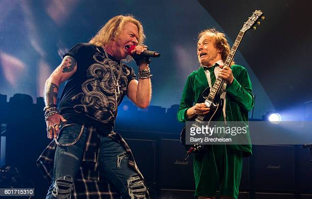 Axl Rose and Angus Young of AC/DC perform during the Rock Or Bust Tour at The Palace of Auburn Hills on September 9, 2016 in Auburn Hills, Michigan.