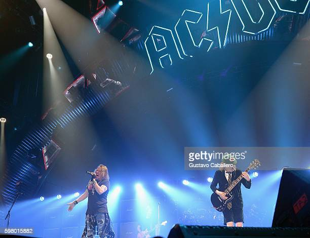 Axl Rose and Angus Young of AC/DC perform onstage at BBT Center on August 30 2016 in Sunrise Florida