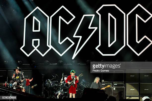 Axl Rose and Angus Young of AC/DC perform the first concert of the Rock or Bust tour at the Passeio Maritimo De Alges on May 7 2016 in Lisbon Portugal