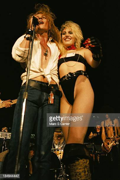 Axl Rose and Desi Craft and Slash of the rock group 'Guns n' Roses' perform at the LA Street Scene on September 28 1985 in Los Angeles California...