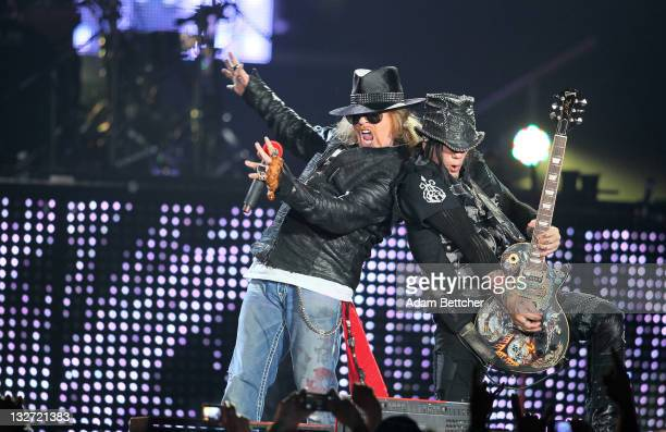Axl Rose and DJ Ashba of the band Guns N Roses performs at Target Center on November 13 2011 in Minneapolis Minnesota