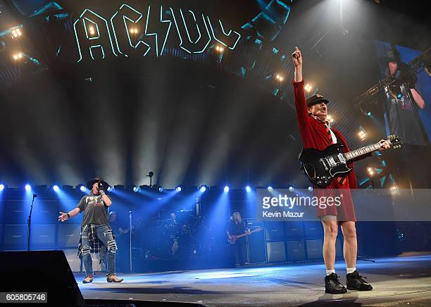 Axl Rose and guitarist Angus Young perform onstage during the AC/DC Rock Or Bust Tour at Madison Square Garden on September 14 2016 in New York City