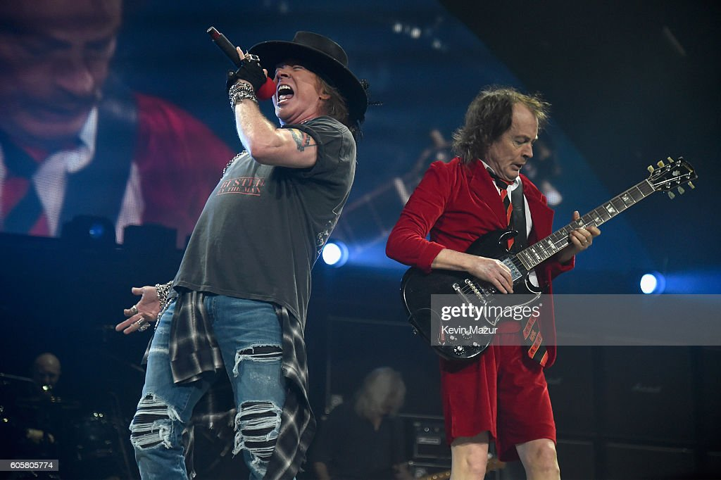 Axl Rose (L) and guitarist Angus Young perform onstage during the AC/DC Rock Or Bust Tour at Madison Square Garden on September 14, 2016 in New York City.