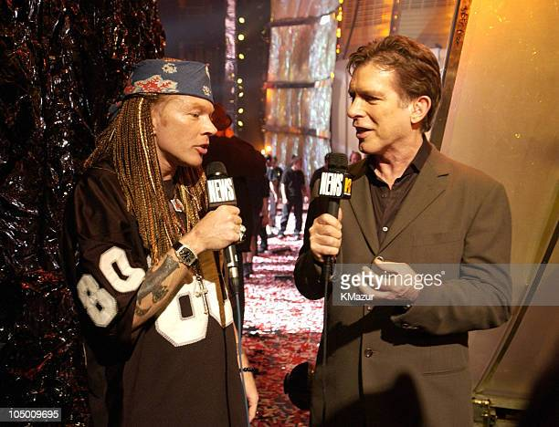 Axl Rose and Kurt Loder during 2002 MTV Video Music Awards Backstage and Audience at Radio City Music Hall in New York City New York United States