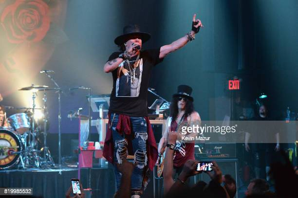 Axl Rose and Slash of Guns N' Roses perform onstage during SiriusXM's Private Show with Guns N' Roses at The Apollo Theater before band embarks on...