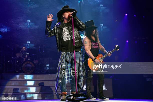 """Axl Rose and Slash of Guns N' Roses perform onstage during the """"Not In This Lifetime..."""" Tour at Madison Square Garden on October 11, 2017 in New..."""
