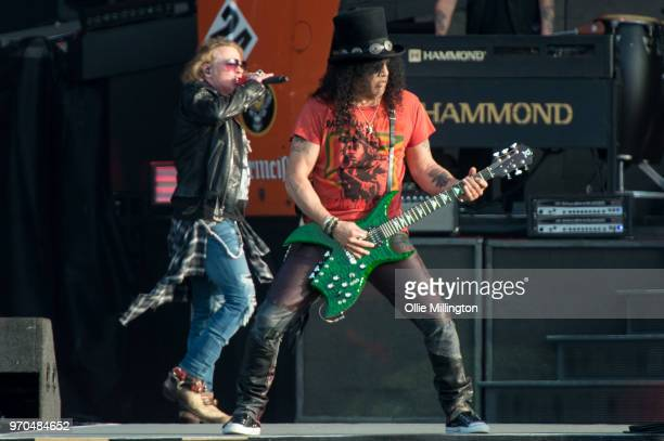 Axl Rose and Slash of Guns N Roses perform onstage on Day 2 of the Download Festival at Donington Park on June 9 2018 in Donington England