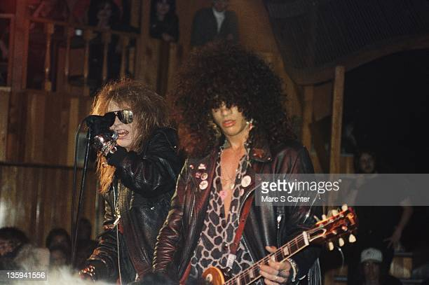 Axl Rose and Slash of the rock band 'Guns n' Roses' perform onstage at the Troubadour on the night that Tom Zutaut of Geffen Records was in...