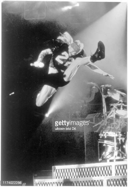 Axl Rose Guns N'Roses jumps in the air 1993