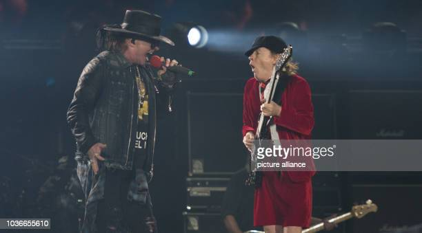 Axl Rose new singer of AC/DC and guitarist Angus Young perform at Volksparkarena in Hamburg Germany 26 May 2016 The band plays a total of three shows...