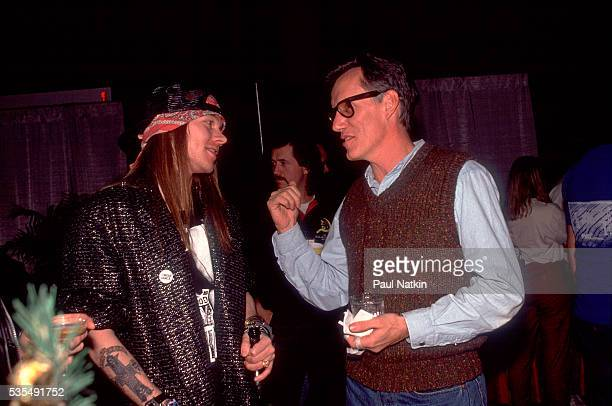 Axl Rose of Guns and Roses talks to actor james Woods at the Steel Wheels Pay Per View Concert at Trump Casino in Atlantic City, New Jersey, December...