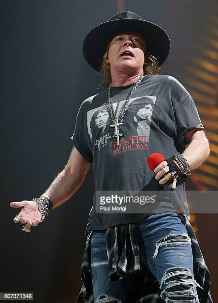 Axl Rose of Guns N' Roses performs with AC/DC during the Rock or Bust Tour Washington DC at the Verizon Center on September 17 2016 in Washington DC