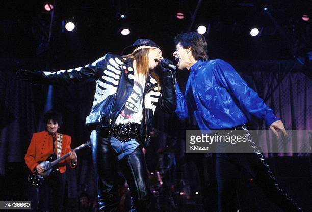 Axl Rose of Guns N' Roses performs with Ron Wood and Mick Jagger of the Rolling Stones in Various Citiescirca 1989