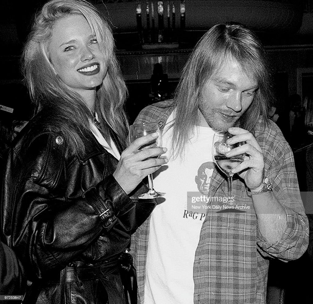 Axl Rose (c.) of the band Guns N' Roses with his new girlfriend Jennifer Driver (left) at the Waldorf.,