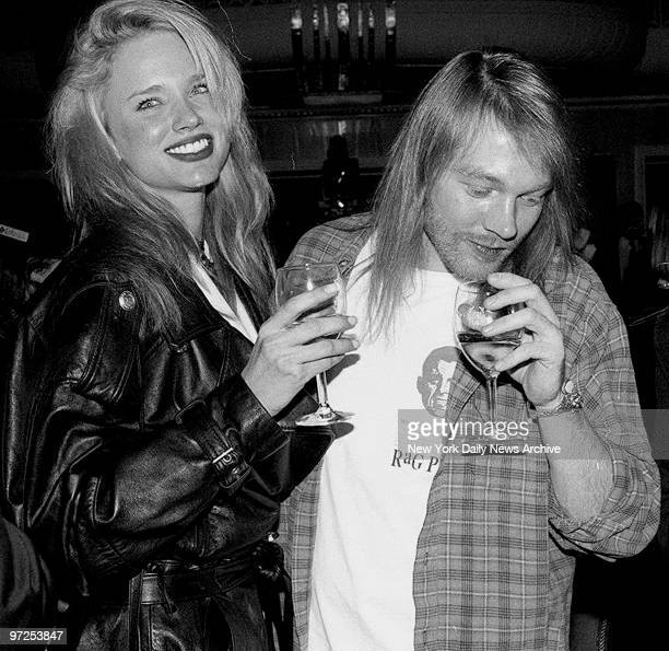 Axl Rose of the band Guns N' Roses with his new girlfriend Jennifer Driver at the Waldorf