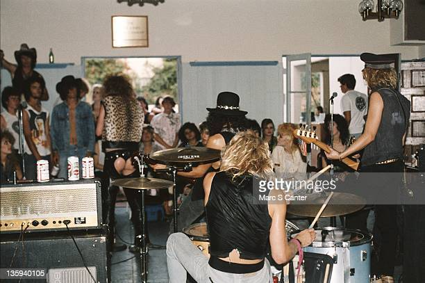 Axl Rose Steven Adler Slash and Duff McKagan of the rock band 'Guns n' Roses' perform onstage at a UCLA frat party where they played 'Welcome To The...