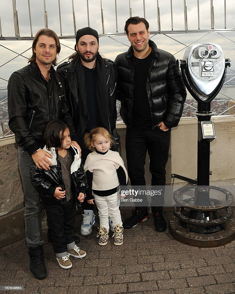 Axwell, Steve Angello and Sebastian Ingrosso of the Swedish House Mafia pose with children at the lighting of The Empire State Building on February 28, 2013 in New York City.