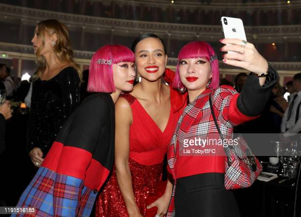 Aya and Ami Suzuki and Nathalie Emmanuel attend the VIP dinner at The Fashion Awards 2019 held at Royal Albert Hall on December 02 2019 in London...