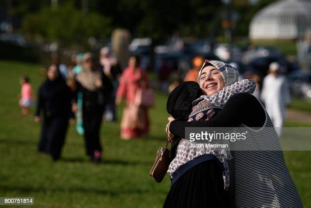Aya Attal of Crafton Pa hugs a friend at an Eid alFitr celebration marking the end of Ramadan on June 25 2017 in Pittsburgh Pennsylvania The...
