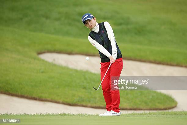 Aya Ezawa of Japan chips onto the 11th green during the first round of the Fujitsu Ladies 2016 at the Tokyu Seven Hundred Club on October 14 2016 in...