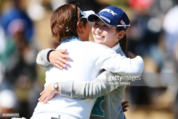 Aya Ezawa of Japan hugs Misuzu Narita of Japan during the second round of the Tokohama Tire PRGR Ladies Cup at Tosa Country Club on March 10 2018 in...