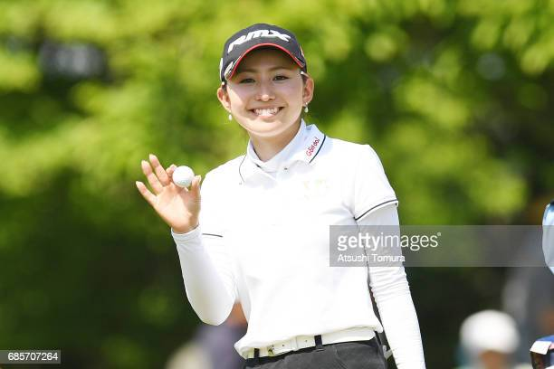 Aya Ezawa of Japan smiles after chipping in her eagle shot on the 17th hole during the final round of the Twin Fields Ladies Tournament at the Golf...