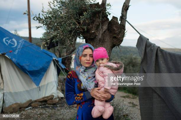 Aya from Syria together with her 7 monthold baby at the makeshift camp in the olive grove next to the Moria refugee camp